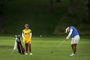 Ariya Jutanugarn  with her caddie/sister Moriya during Quarterfinals at the 63rd U. S.  Girls' Junior Championship.