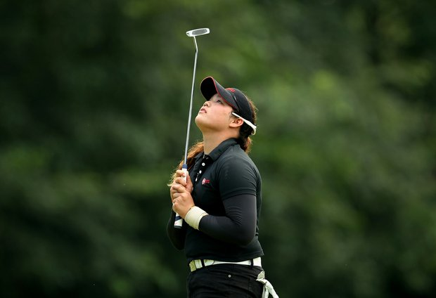 Ariya Jutanugarn reacts to her putt at No 16 during the afternoon round of the final match at the 63rd U. S.  Girls' Junior Championship.