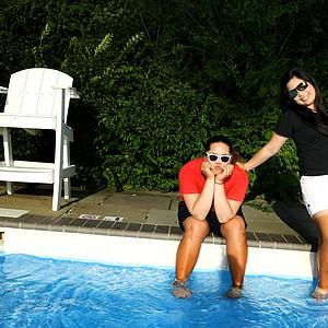 Ariya Jutanugarn, left, with her older sister Moriya Jutanugarn during a recent photo shoot at the 2012 Women's Amateur in Cleveland.