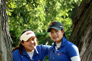 Ariya Jutanugarn, left, and Moriya Jutanugarn during the 2011 U. S. Girls Junior at Olympia Fields.