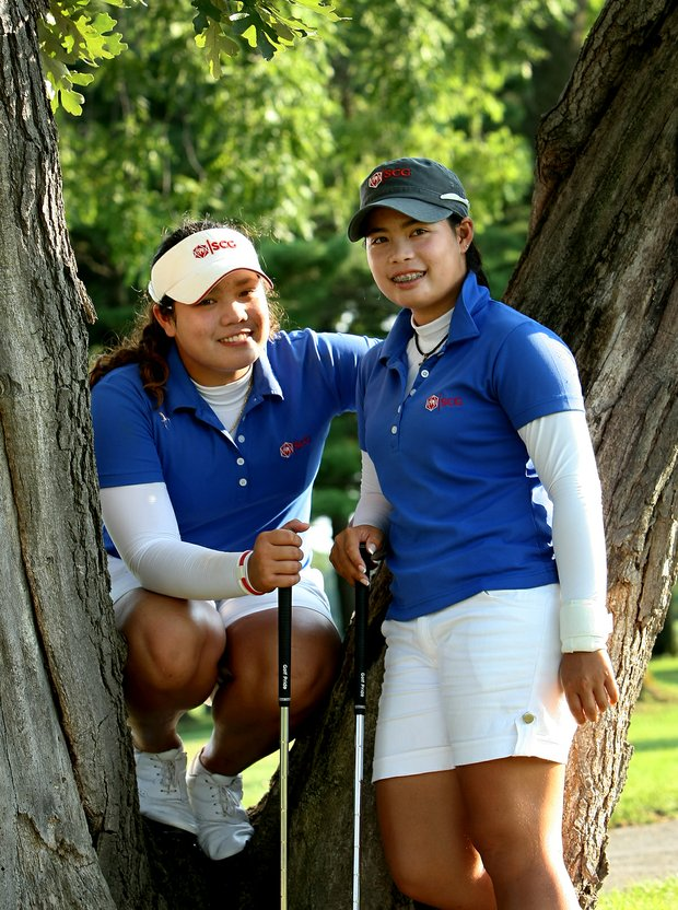 Ariya Jutanugarn, left, and Moriya Jutanugarn during the 2011 U. S. Girls Junior at Olympia Fields.