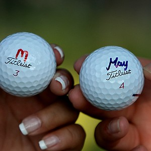 "The Jutanugarn sisters mark their golf balls by their nicknames. Ariya goes by ""May"" and Moriya goes by ""Mo."""