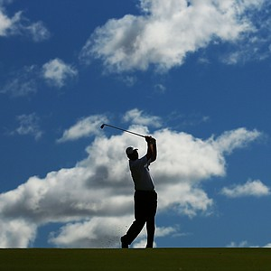 PERTH, AUSTRALIA - OCTOBER 18: Marcus Cain of Australia plays his approach shot on the 13th hole during round one of the Perth International at Lake Karrinyup Country Club on October 18, 2012 in Perth, Australia.