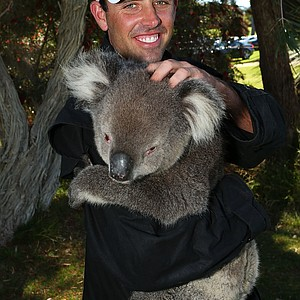 PERTH, AUSTRALIA - OCTOBER 18: Charl Schwartzel of South Africa handles a Koala after completing his first round during round one of the Perth International at Lake Karrinyup Country Club on October 18, 2012 in Perth, Australia.