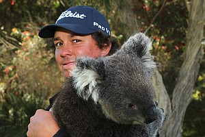 US golfer Jason Dufner holds a koala after the first day of the Perth International golf tournament at Lake Karrinyup in Perth on October 18, 2012. Dufner is the favourite for the event worth 2.04 million.