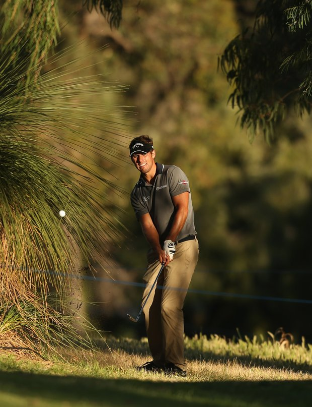 PERTH, AUSTRALIA - OCTOBER 18: Andrea Pavan of Italy plays an approach shot on the 9th hole during day one of the Perth International at Lake Karrinyup Country Club on October 18, 2012 in Perth, Australia.