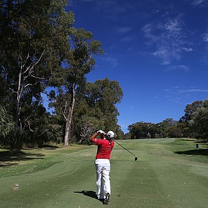 PERTH, AUSTRALIA - OCTOBER 20: (EDITORS NOTE: A Polarising lens was used in the creation of this image.) Terry Pilkadaris of Australia tees off on the 4th hole during round three of the Perth International at Lake Karrinyup Country Club on October 20, 2012 in Perth, Australia.