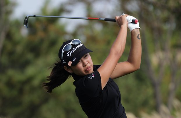 INCHEON, SOUTH KOREA - OCTOBER 20: Mina Harigae of the United States plays a shot on the 3rd hole during the second round of KEB-HanaBank Championship at Sky 72 Golf Club Ocean Course on October 20, 2012 in Incheon, South Korea.