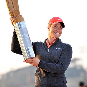 Suzann Pettersen of Norway holds up the trophy at the awards ceremony after winning the LPGA KEB-HanaBank Championship golf tournament at the Sky72 Golf Club in Incheon, west of Seoul, on October 21, 2012. Pettersen edged Catriona Matthew of Scotland on the third hole of the sudden death playoff.