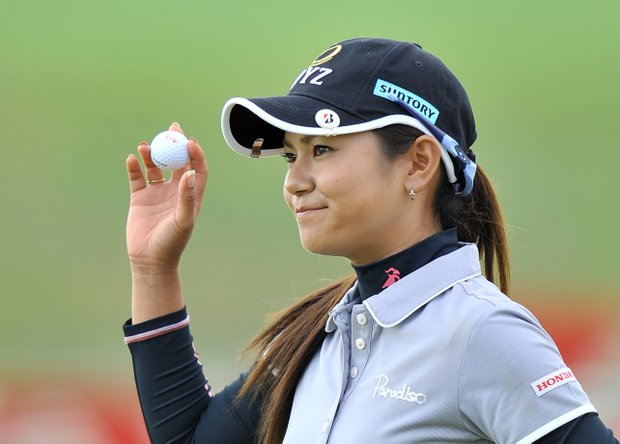 Ai Miyazato of Japan acknowledges the crowd after a putt during the final round of the LPGA KEB-HanaBank Championship golf tournament at Sky72 Golf Club in Incheon, west of Seoul, on October 21, 2012. Miyazato finished in 20th place.