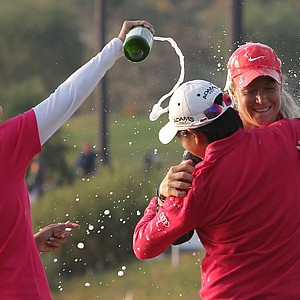 INCHEON, SOUTH KOREA - OCTOBER 21: Suzann Pettersen of Norway celebrate with Yani Tseng of Taiwan after the winning of the KEB-HanaBank Championship at Sky 72 Golf Club Ocean Course on October 21, 2012 in Incheon, South Korea.