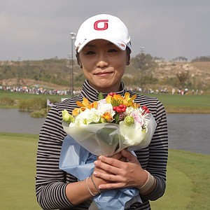 INCHEON, SOUTH KOREA - OCTOBER 21: Mi-Hyun Kim of South Korea holds flowers after her farewell match on the 9th hole during the final round of KEB-HanaBank Championship at Sky 72 Golf Club Ocean Course on October 21, 2012 in Incheon, South Korea.