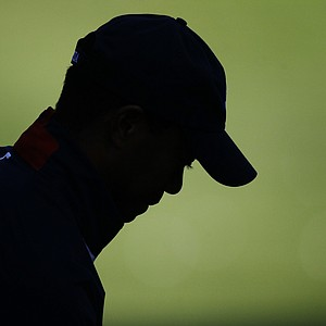 USA's Tiger Woods hits a shot on the range at the Ryder Cup PGA golf tournament Thursday, Sept. 27, 2012, at the Medinah Country Club in Medinah, Ill.
