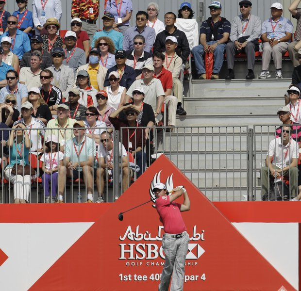 Rory McIlroy from Northern Ireland tees off on the 1st hole during the second round of Abu Dhabi HSBC Championship, Friday, Jan. 27, 2012, in Abu Dhabi, United Arab Emirates.