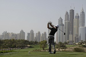 Rory McIlroy from Northern Ireland tees off on the 8th hole during the third round of Dubai Desert Classic, in Dubai, United Arab Emirates, Saturday, Feb. 11, 2012.