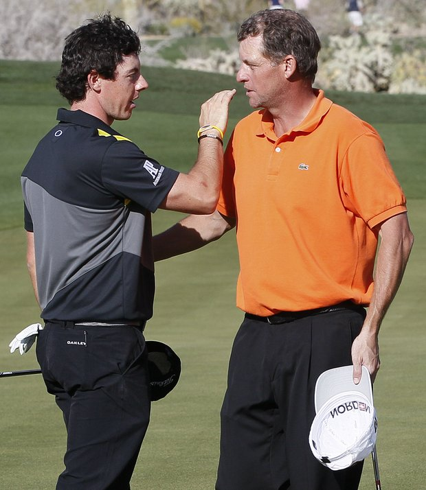 Northern Ireland's Rory McIlroy, left, greets Anders Hansen after defeating him 3 and 2 during the Match Play Championship golf tournament on Thursday, Feb. 23, 2012, in Marana, Ariz.