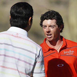 Northern Ireland's Rory McIlroy, right, is congratulated by South Korea's Sang-moon Bae after McIlroy won their quarterfinal match 3 and 2 at the Match Play Championship golf tournament, Saturday, Feb. 25, 2012, in Marana, Ariz.