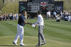 Lee Westwood of England, left, congratulates Rory McIlroy of Northern Ireland on his 3 and 2 semifinal win during the Match Play Championship golf tournament, Sunday, Feb. 26, 2012, in Marana, Ariz.