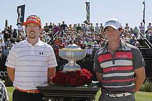Hunter Mahan, left, and Rory McIlroy, of Northern Ireland, stand for a photo next to the Walter Hagen Cup before playing in the final round of the Match Play Championship golf tournament on Sunday, Feb. 26, 2012, in Marana, Ariz.