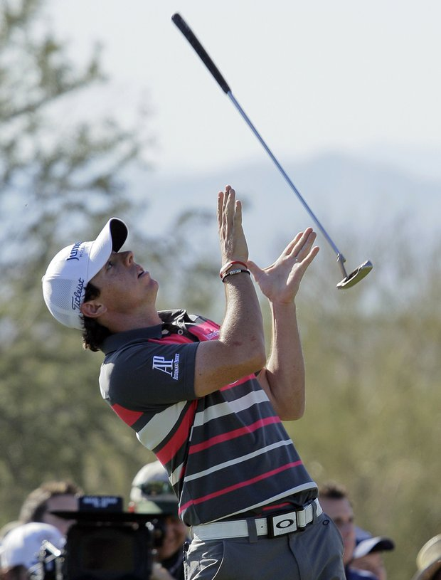 Rory McIlroy catches his club after tossing it up in response to a missed putt on the 17th green against Hunter Mahan in the final round during the Match Play Championship golf tournament on Sunday, Feb. 26, 2012, in Marana, Ariz. Mahan won 2 and 1.