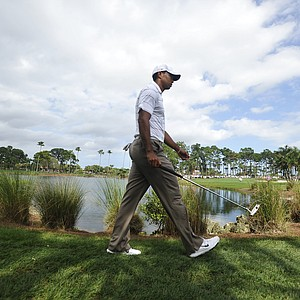 Tiger Woods walks to the eighth green during the first round of the Honda Classic golf tournament in Palm Beach Gardens, Fla., Thursday, March 1, 2012.