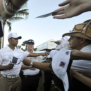 Tiger Woods signs autographs after finishing the first round of the Honda Classic golf tournament in Palm Beach Gardens, Fla., Thursday, March 1, 2012.