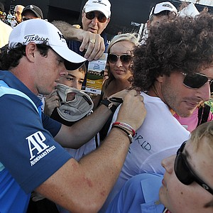 Rory McIlroy, of Northern Ireland, signs autographs after finishing the second round of the Honda Classic golf tournament in Palm Beach Gardens, Fla., Friday, March 2, 2012.
