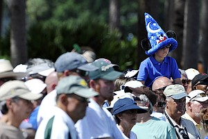 A young fan watches Rory McIlroy putt on the third hole during the second round of the Honda Classic golf tournament in Palm Beach Gardens, Fla., Friday, March 2, 2012.