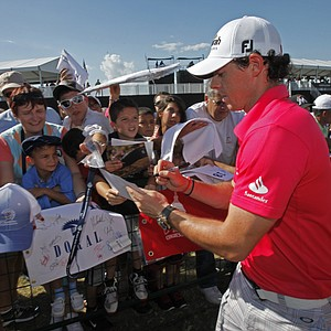 Rory McIlroy of Northern Ireland, signs autographs after completing the third round of the Cadillac Championship golf tournament on Saturday, March 10, 2012 in Doral, Fla.