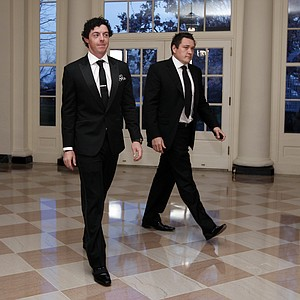 Professional golfer Rory McIlroy and Conor Ridge arrive at the Booksellers area of the White House in Washington for the State Dinner hosted by President Barack Obama and first lady Michelle Obama for British Prime Minister David Cameron and his wife Samantha, Wednesday, March 14, 2012.