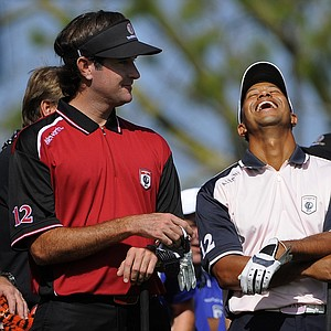 Team Isleworth's Bubba Watson, left, and Team Albany's Tiger Woods laugh at the announcer's joke as they wait to tee off at the first tee during the two-day Tavistock Cup exhibition golf tournament at Lake Nona Golf & Country Club Monday, March 19, 2012, in Orlando, Fla.