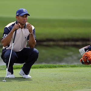 Team Albany's Tiger Woods sets up for a putt on the second green during the two-day Tavistock Cup exhibition golf tournament at Lake Nona Golf & Country Club Tuesday, March 20, 2012, in Orlando, Fla.
