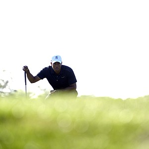 Tiger Woods lines up his putt on the 12th green during the first round of the Arnold Palmer Invitational golf tournament at Bay Hill in Orlando, Fla., Thursday, March 22, 2012.