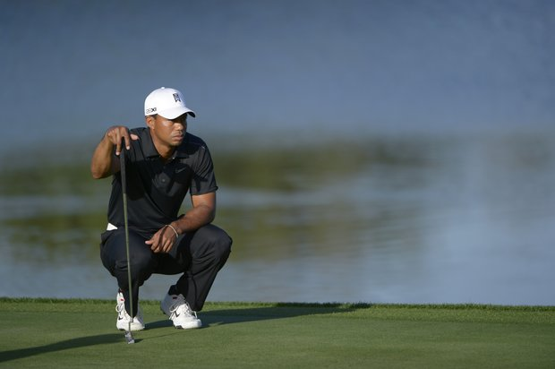 Tiger Woods lines up his putt on the 11th green during the first round of the Arnold Palmer Invitational golf tournament at Bay Hill in Orlando, Fla., Thursday, March 22, 2012.