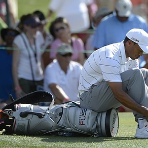 Tiger Woods adjusts his shoelaces after putting out on the 13th green during the second round of the Arnold Palmer Invitational golf tournament at Bay Hill in Orlando, Fla., Friday, March 23, 2012.