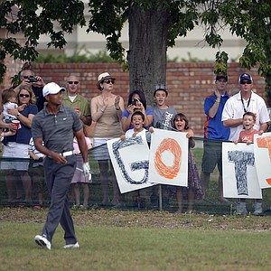 Fans cheer for Tiger Woods, left, after he hit his shot from the 15th fairway during the third round of the Arnold Palmer Invitational golf tournament at Bay Hill in Orlando, Fla., Saturday, March 24, 2012.