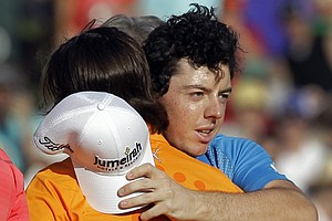 Rory McIlroy, of Northern Ireland, right, embraces Rickie Fowler, left, after Fowler defeated McIlroy and D.A. Points on the first playoff hole to win the Wells Fargo Championship golf tournament at Quail Hollow Club in Charlotte, N.C., Sunday, May 6, 2012.