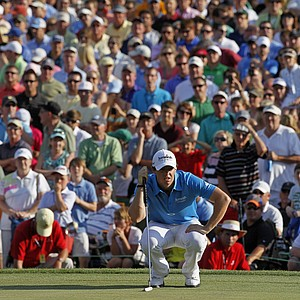 Rory McIlroy, of Northern Ireland, lines up a putt on the 18th green during the final round of the Wells Fargo Championship golf tournament at Quail Hollow Club in Charlotte, N.C., Sunday, May 6, 2012.