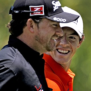 Graeme McDowell, left, and Rory McIlroy, both from Northern Ireland, laugh as they walk off the 14th hole during a practice round for The Players Championship golf tournament Wednesday, May 9, 2012, at Sawgrass in Ponte Vedra Beach, Fla.