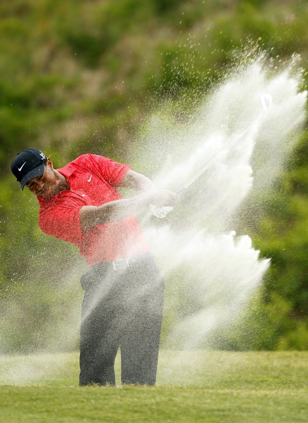 Tiger Woods hits from the sand on the sixth hole during the final round of the Players Championship golf tournament at TPC Sawgrass, Sunday, May 13, 2012, in Ponte Vedra Beach, Fla.