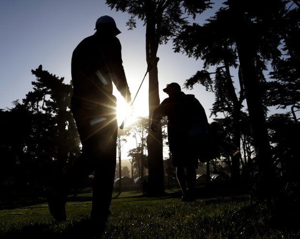 Tiger Woods, left, and his his caddie Joe LaCava make their way to the 10th tee during a practice round for the U.S. Open Championship golf tournament Monday, June 11, 2012, in San Francisco.