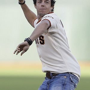 Golfer Rory McIlroy, of Northern Ireland, throws out the ceremonial first pitch before a baseball game between the San Francisco Giants and the Houston Astros in San Francisco, Tuesday, June 12, 2012.