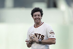 Golfer Rory McIlroy, of Northern Ireland, throws out the ceremonial first pitch before of a baseball game between the San Francisco Giants and the Houston Astros in San Francisco, Tuesday, June 12, 2012.