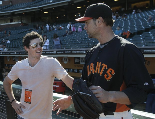 Golfer Rory McIlroy, left, of Northern Ireland, talks with San Francisco Giants pitcher Ryan Vogelsong before a baseball game between the Giants and the Houston Astros in San Francisco, Tuesday, June 12, 2012. McIlroy will throw out the ceremonial first pitch.