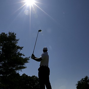 Tiger Woods tees off from the ninth tee during a pro-am round of the AT&T National golf tournament at Congressional Country Club in Bethesda, Md., Wednesday, June 27, 2012.