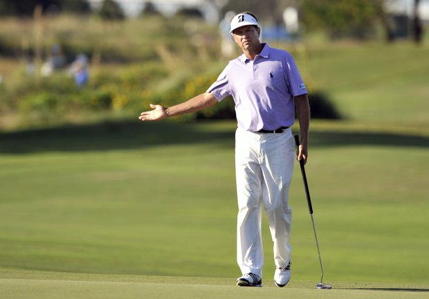 Davis Love III reacts to his putt on the 18th green during the second round of the McGladrey Classic PGA Tour golf tournament on Friday, Oct. 19, 2012, in St. Simons Island, Ga.