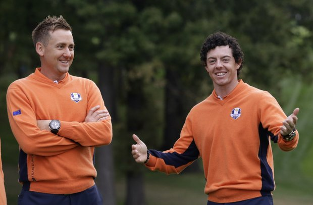 Europe's Rory McIlroy, right, and Ian Poulter have some fun during the Ryder Cup PGA golf tournament Tuesday, Sept. 25, 2012, at the Medinah Country Club in Medinah, Ill.