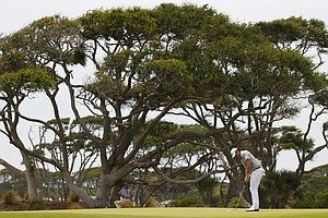 Rory McIlroy, of Northern Ireland, putts on the third green during the second round of the PGA Championship golf tournament on the Ocean Course of the Kiawah Island Golf Resort in Kiawah Island, S.C., Friday, Aug. 10, 2012.