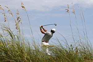 Rory McIlroy, of Northern Ireland, watches his drive from the fourth tee during the second round of the PGA Championship golf tournament on the Ocean Course of the Kiawah Island Golf Resort in Kiawah Island, S.C., Friday, Aug. 10, 2012.