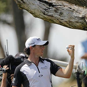 Rory McIlroy of Northern Ireland looks at his ball after pulling it from a tree on the third hole during the third round of the PGA Championship golf tournament on the Ocean Course of the Kiawah Island Golf Resort in Kiawah Island, S.C., Saturday, Aug. 11, 2012.